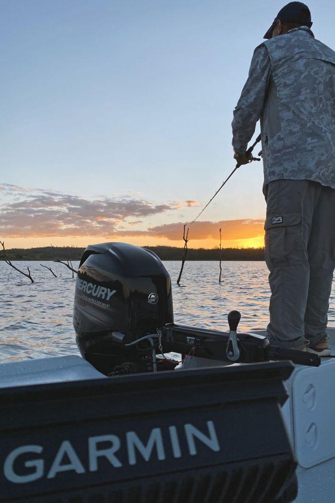Luke fishing at sunset